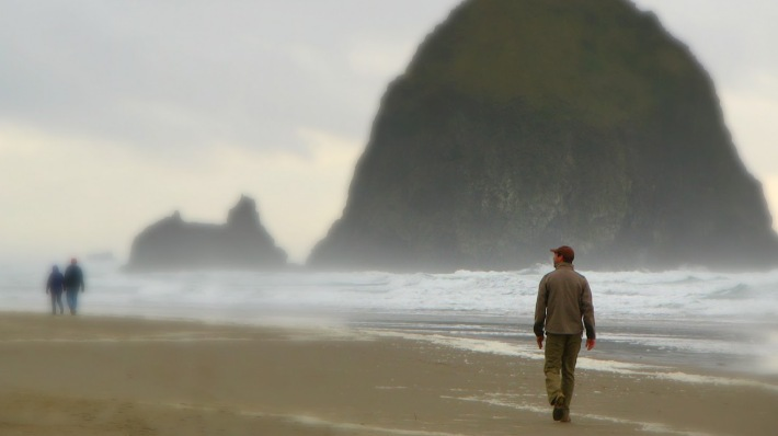 man-walking-in-cannon-beach